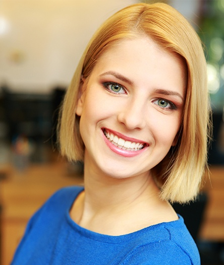 blonde woman with perfect smile smiling
