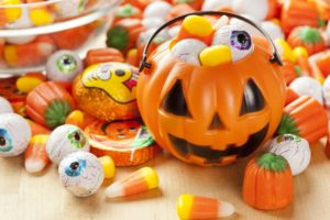 Use Halloween oral health tips for this Halloween pail full of candy